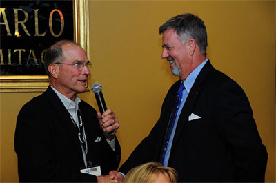 2011 Multi-Unit Franchising Conference Chairman Charles Smithgall, left, Congratulates 2012 Chairman John Metz